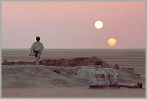 Luke looking off at twin suns